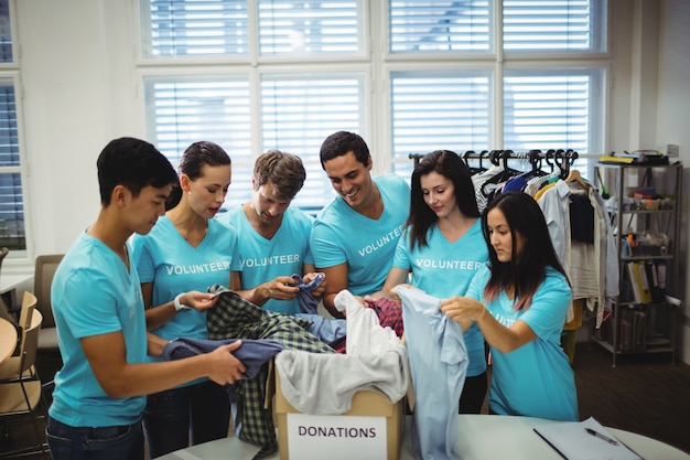 Group of volunteers checking clothes