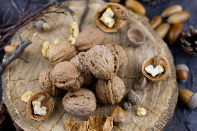 A group of walnuts on dark. hazelnuts harvested in autumn