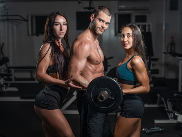 Group with dumbbell weight training equipment on sport gym.