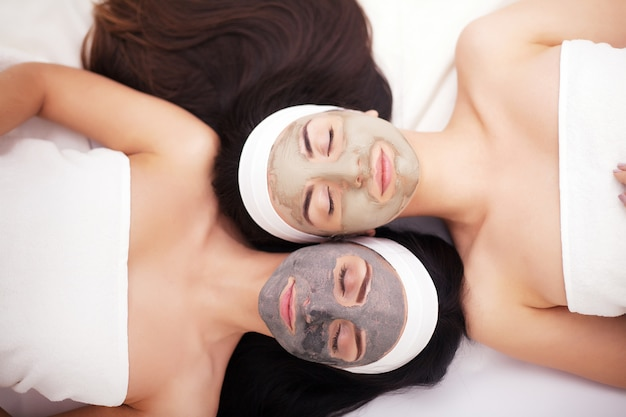 Group woman getting facial mask and gossip