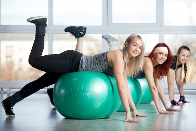 Group of women doing exercises on balls