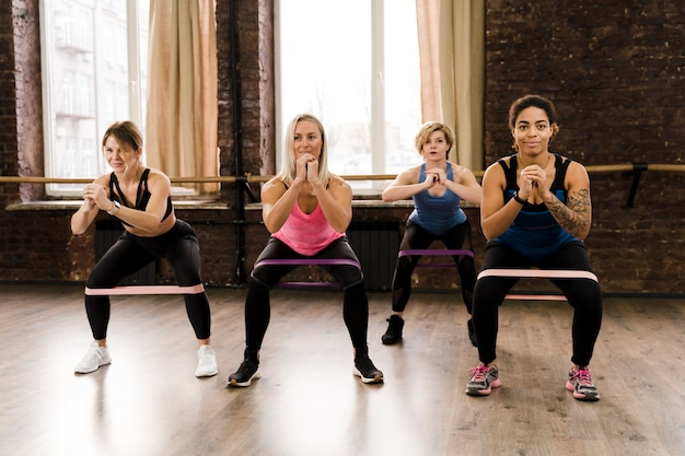 Group of women doing pilates together at the gym