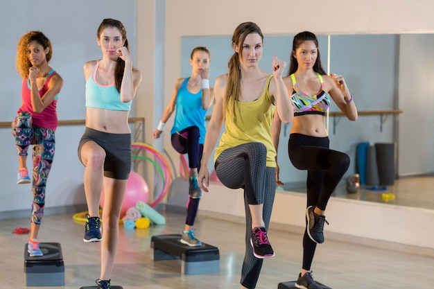 Group of women exercising on aerobic stepper