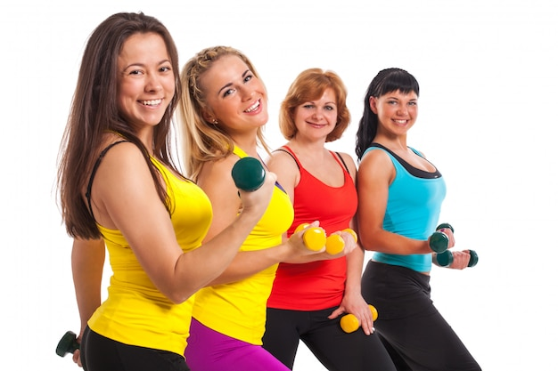 Group of women exercising over background