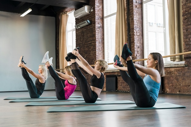 Group of women exercising together at the gym