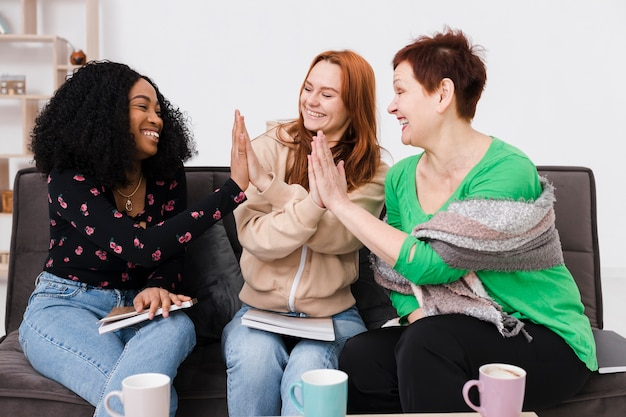 Group of women high fiving