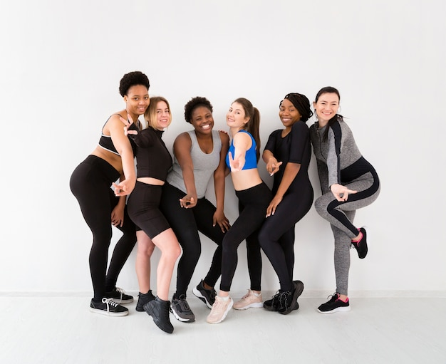 Group of women posing after fitness class