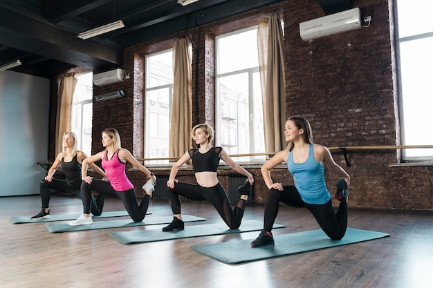 Group of women training together at the gym