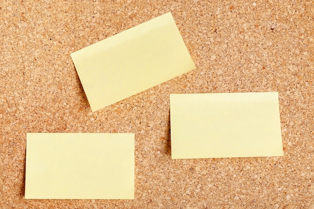 Group of yellow blank sticker mockup with pinned on cork board