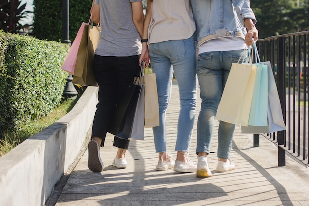 Group of young asian woman shopping in an outdoor market with shopping bags in their hands