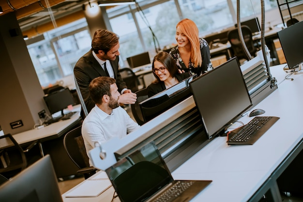 Group of young business people are working together with desktop computer