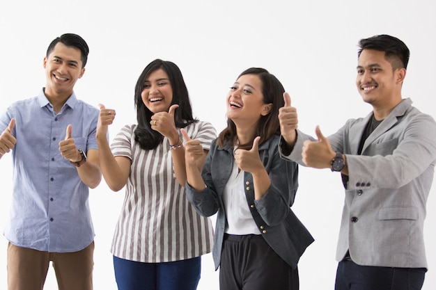 Group of young business people thumb up