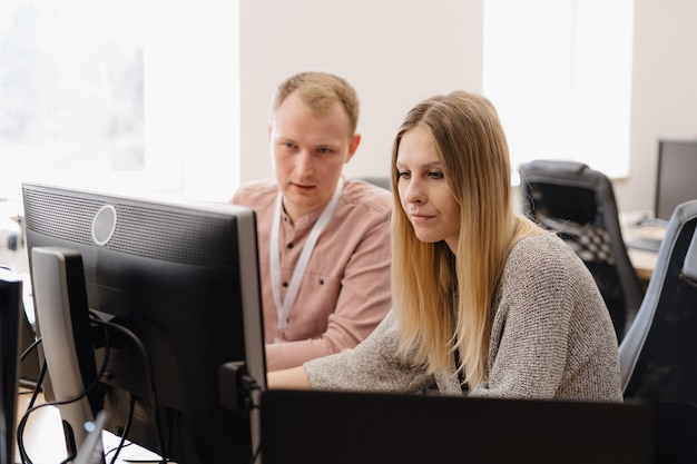 Group of young business people working in the office