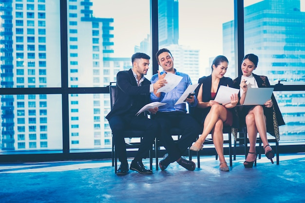 A group of young businessmen are discussing happily. for creative work