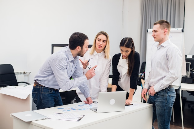 Group young coworkers making great business decisions.creative team discussion corporate work concept modern office. startup marketing idea presentation.