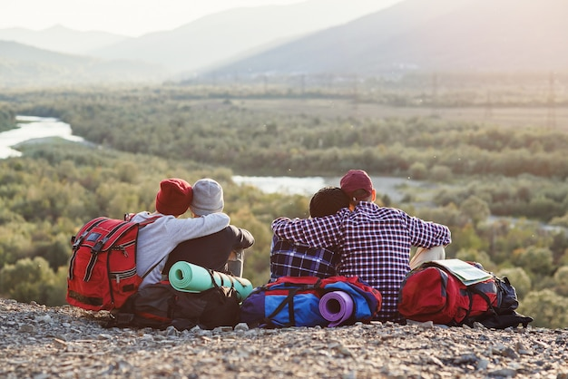 Group of young friends traveling together in mountains.