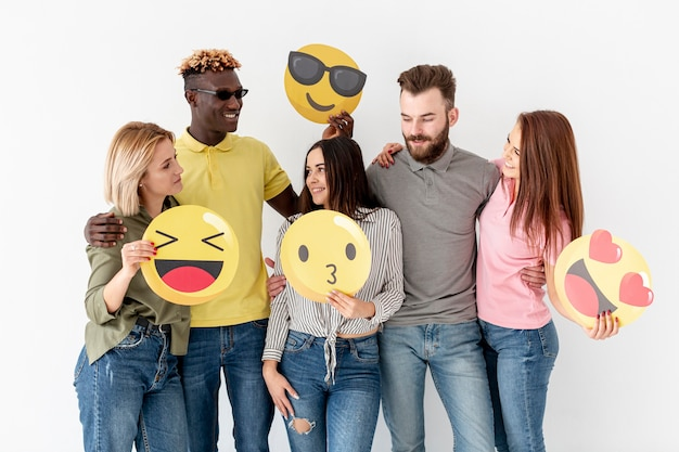 Group of young friends with emoji
