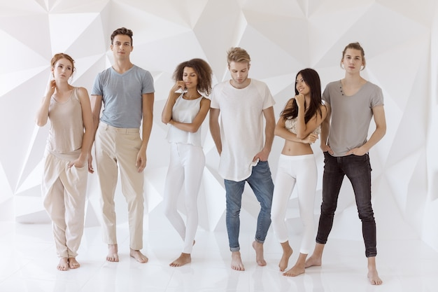 Group of young multi-ethnic beautiful people wearing casual clothes smiling and having fun