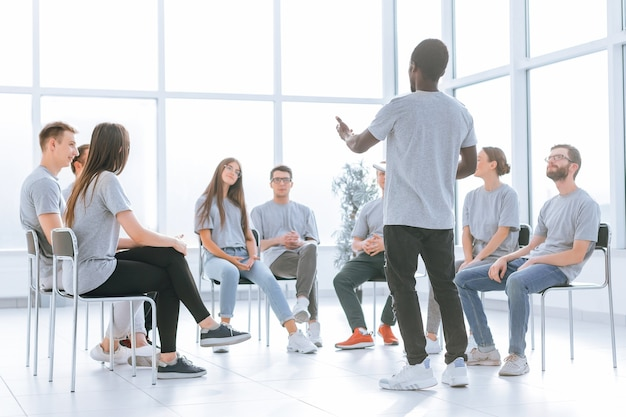 Group of young people applauding at a business training
