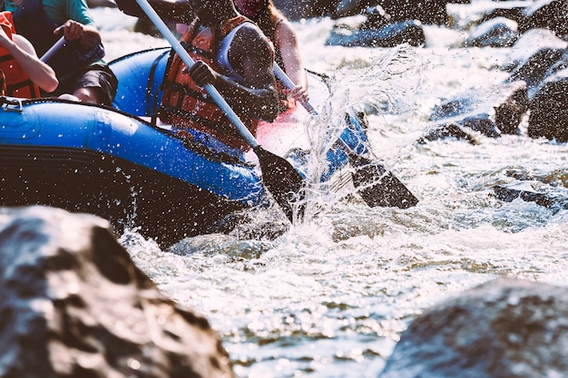 A group of young people are rafting in a river. close-up