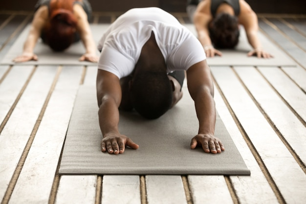 Group of young people in balasana exercise