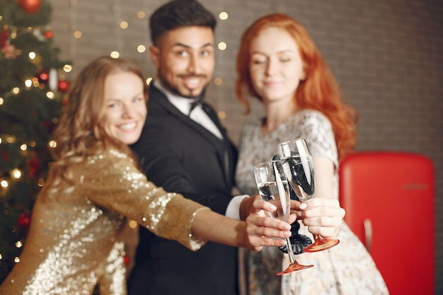 Group of young people celebrating new year. women with indian man.