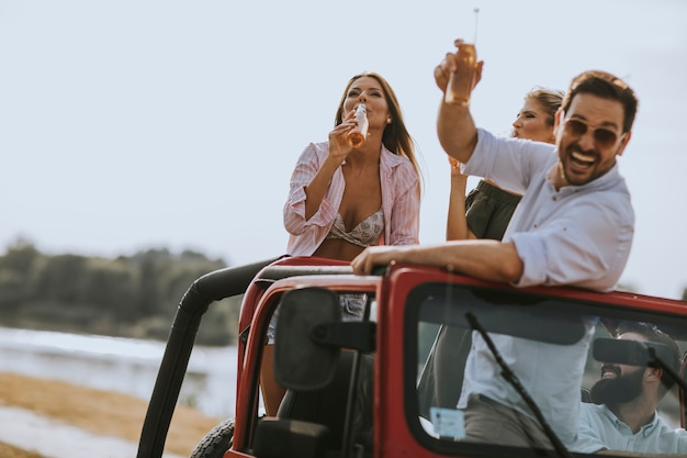Group of young people enjoying road trip