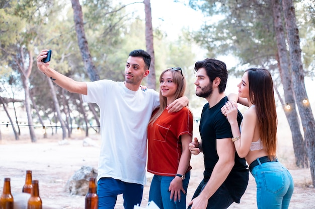 Group of young people make selfie outdoors