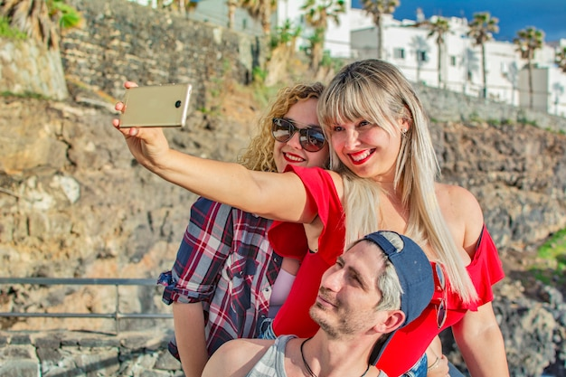 Group of young people taking a selfie outdoors