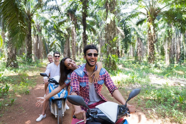 Group of young people travel in tropical forest