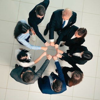 Group of young professionals standing in a circle