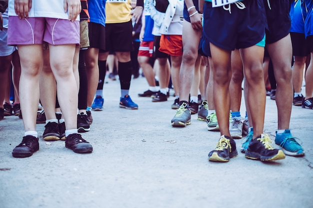Group of youth marathon runners on start line.