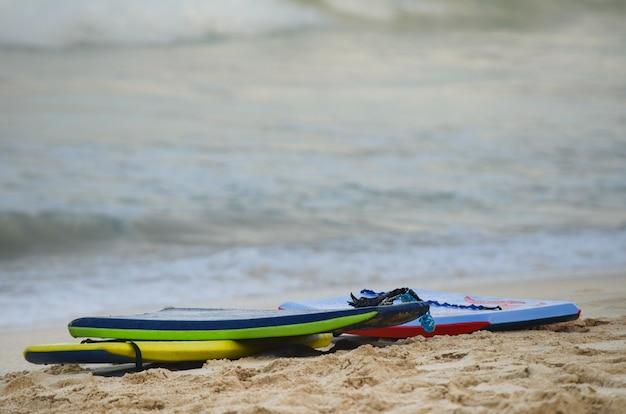 Grouping of 3 boogie boards on waimanalo beach in oahu, hawaii