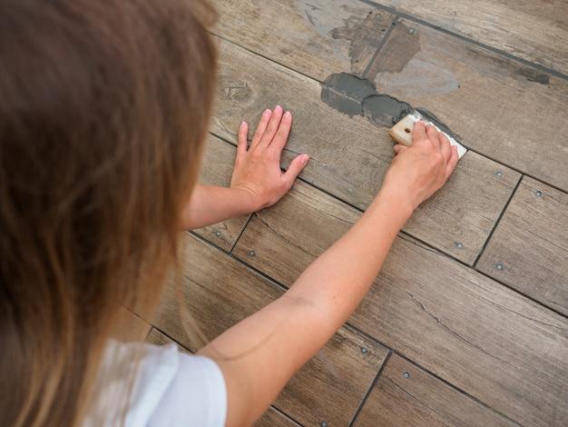 Grouting between ceramic tiles