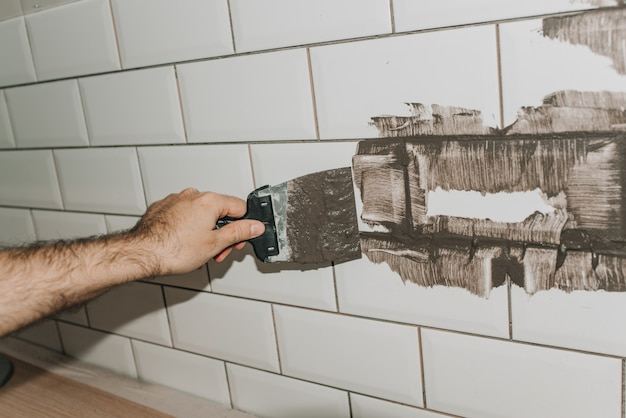 Grouting tiles in the kitchen repair tile hog