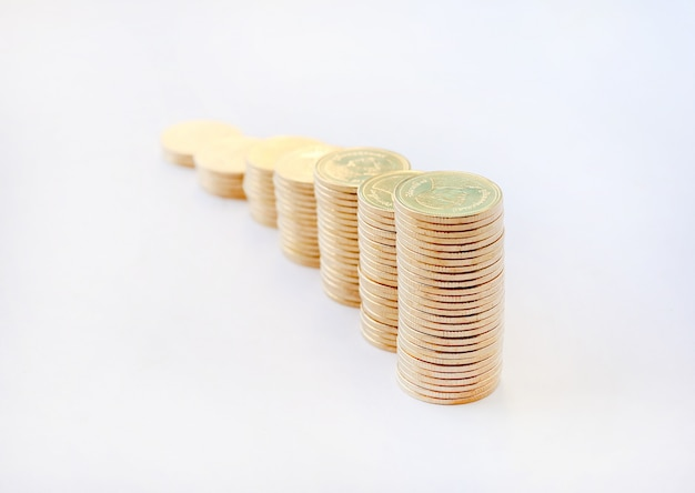 Growing of gold coins stack on white background, business finance and money concept.