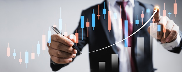 Growing up of business finance technology and investment trading trader investor. stock market investments funds and digital assets. businessman analyzing forex trading graph financial marketing data.