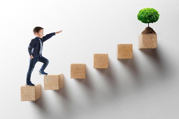 成長ビジネスコンセプト。キャリアのはしごを登る青年実業家