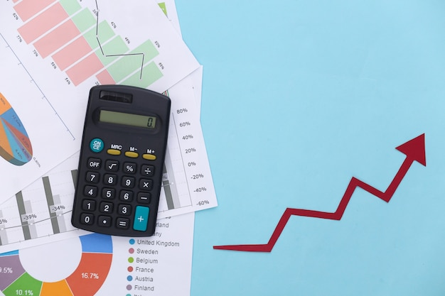 Growth upward arrow, graphs and charts and calculator on blue. business success