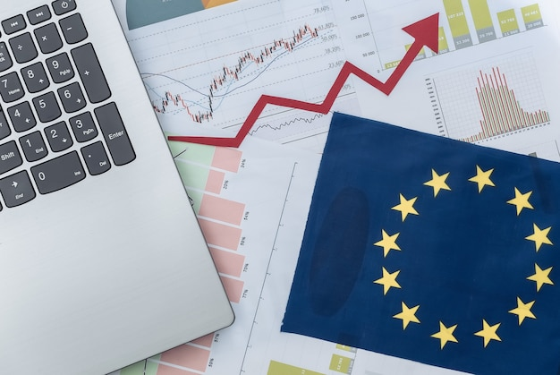 Growth upward arrow, graphs and charts with laptop and eu flag