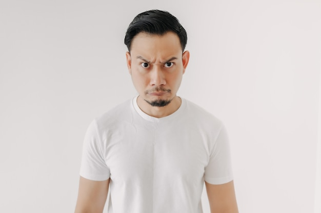 Grumpy face man in white tshirt isolated on white background