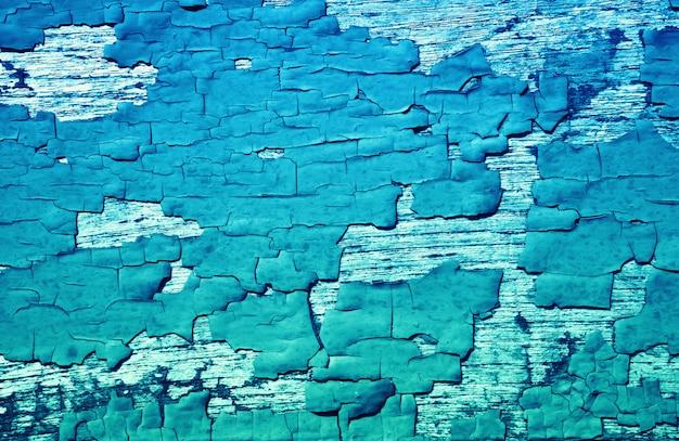 Grungひびの入った青い色の塗料壁テクスチャ背景