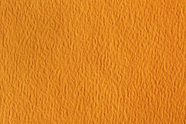Гранж-фон в красной, оранжевой, желтой бумаге.