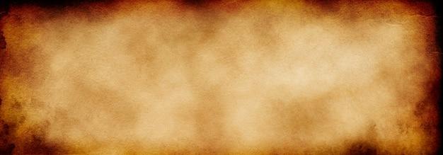 공간의 복사본이 있는 거친 갈색 골동품 종이의 그루지 배경