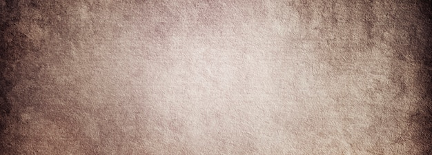 Grunge background of old brown paper with a place for text and a copy of the space