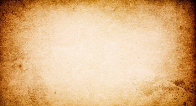 Grunge background of old paper with a light center for text and design