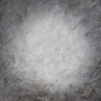 Гранж-фон, текстура и детали бетонной стены в стиле лофт с виньеткой и ярким кругом посередине