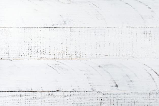 古い白い木の板とグランジの背景。横縞。