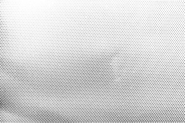 グランジの黒と白の苦痛。ドットテクスチャ背景。ハーフトーンドットグランジテクスチャ。