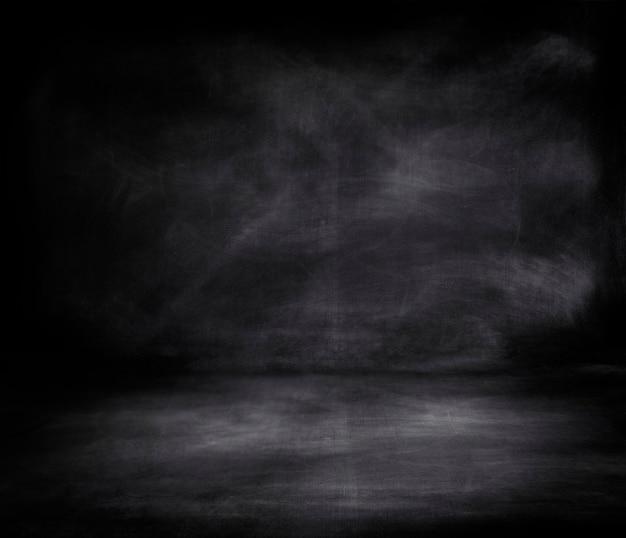 Grunge black chalkboard textured background